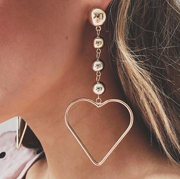 Fashion Movements: long heart pendal earrings jewelry