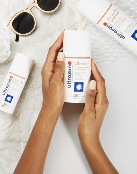 Ultrasun - Schimmernde Sonnenschutz-Lotion für empfindliche Haut, LSF 20, 100 ml - Transparent